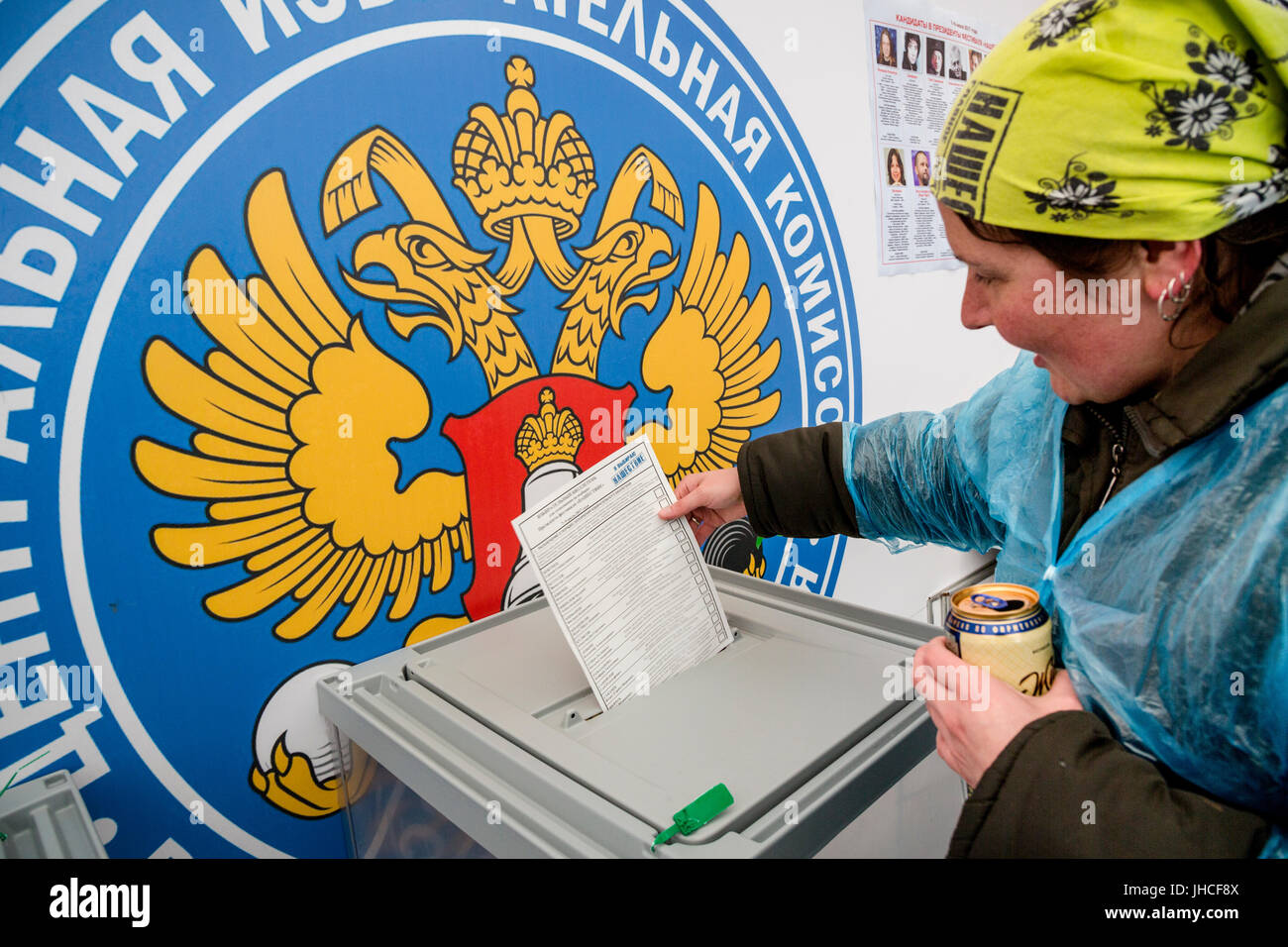 A girl throws a completed ballot in the ballot box during the election of the president of the 'Nashestvie-2017' - Stock Image