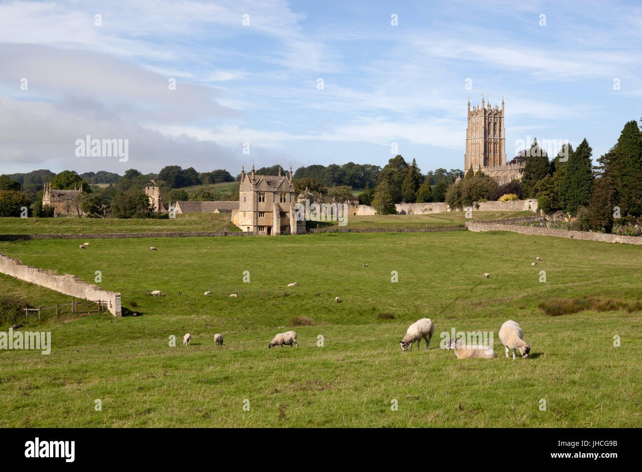 St James' Church and East Banqueting House of Campden House with grazing sheep, Chipping Campden, Cotswolds, - Stock Image