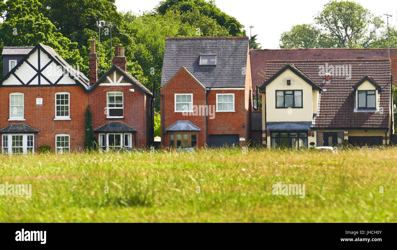Houses in The Green road photographed looking across the green, Theydon Bois, Essex Stock Photo
