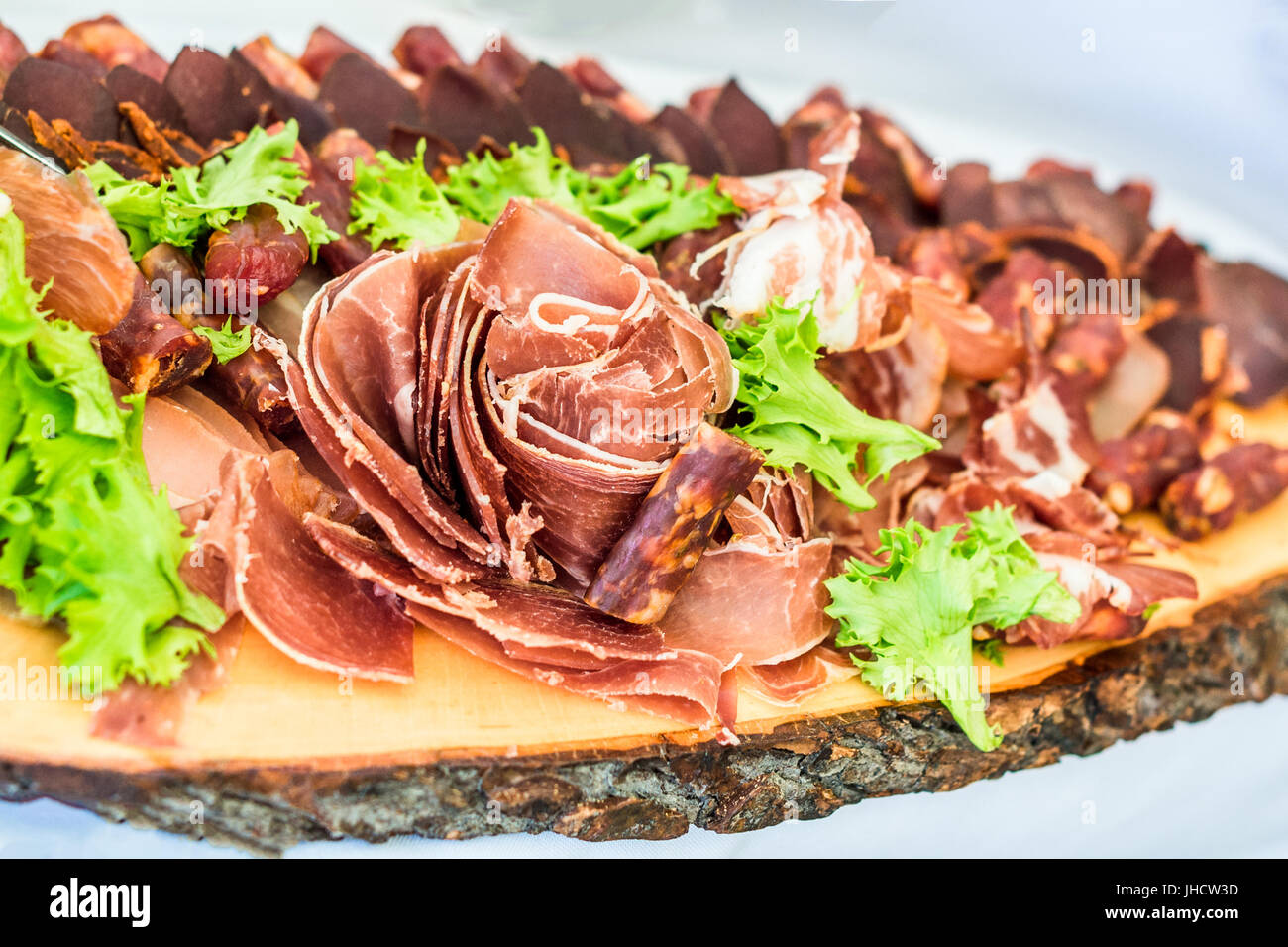 Sausage slices on board - Stock Image