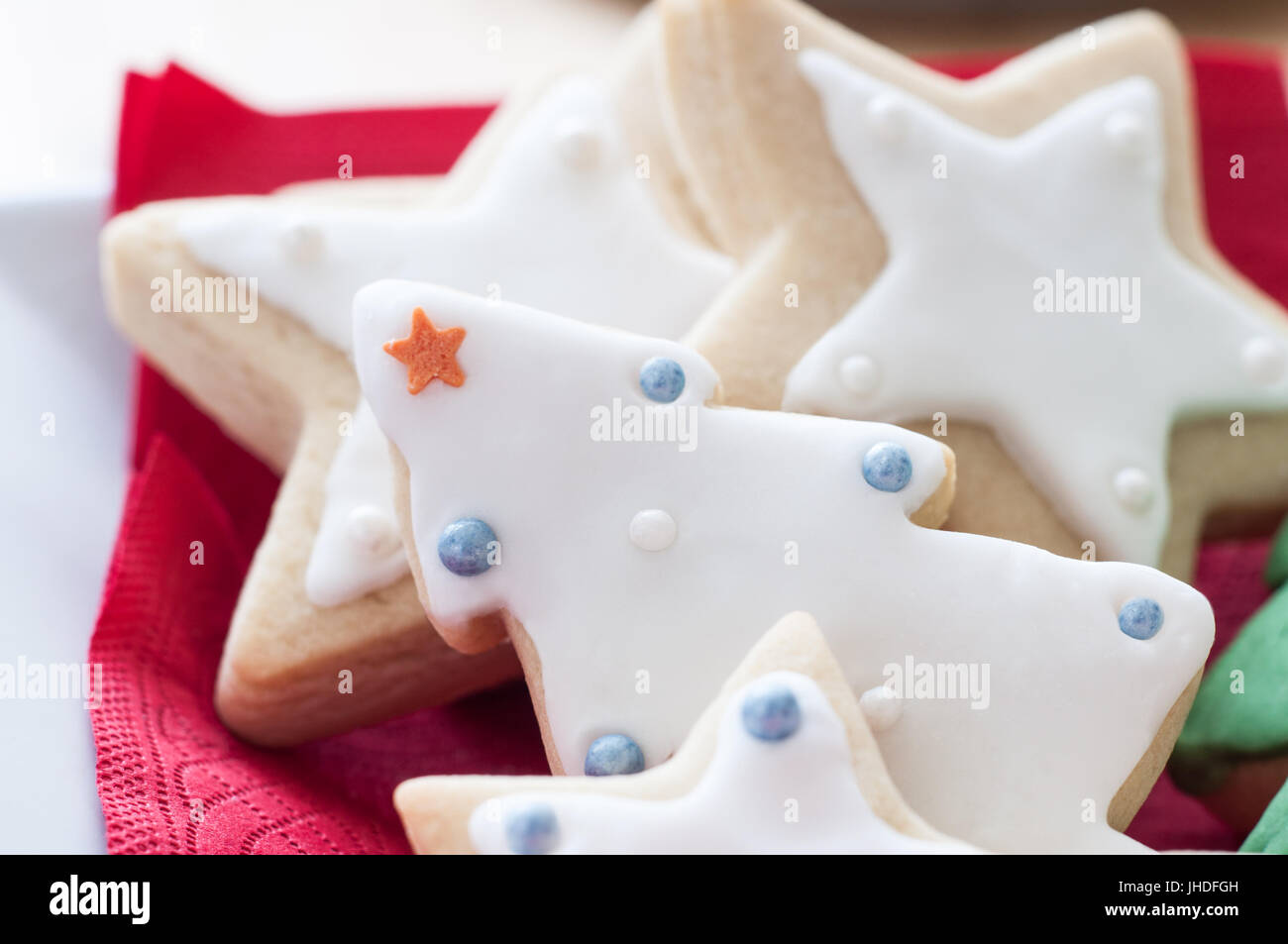 A selection of iced and decorated Christmas biscuits, in tree and ...