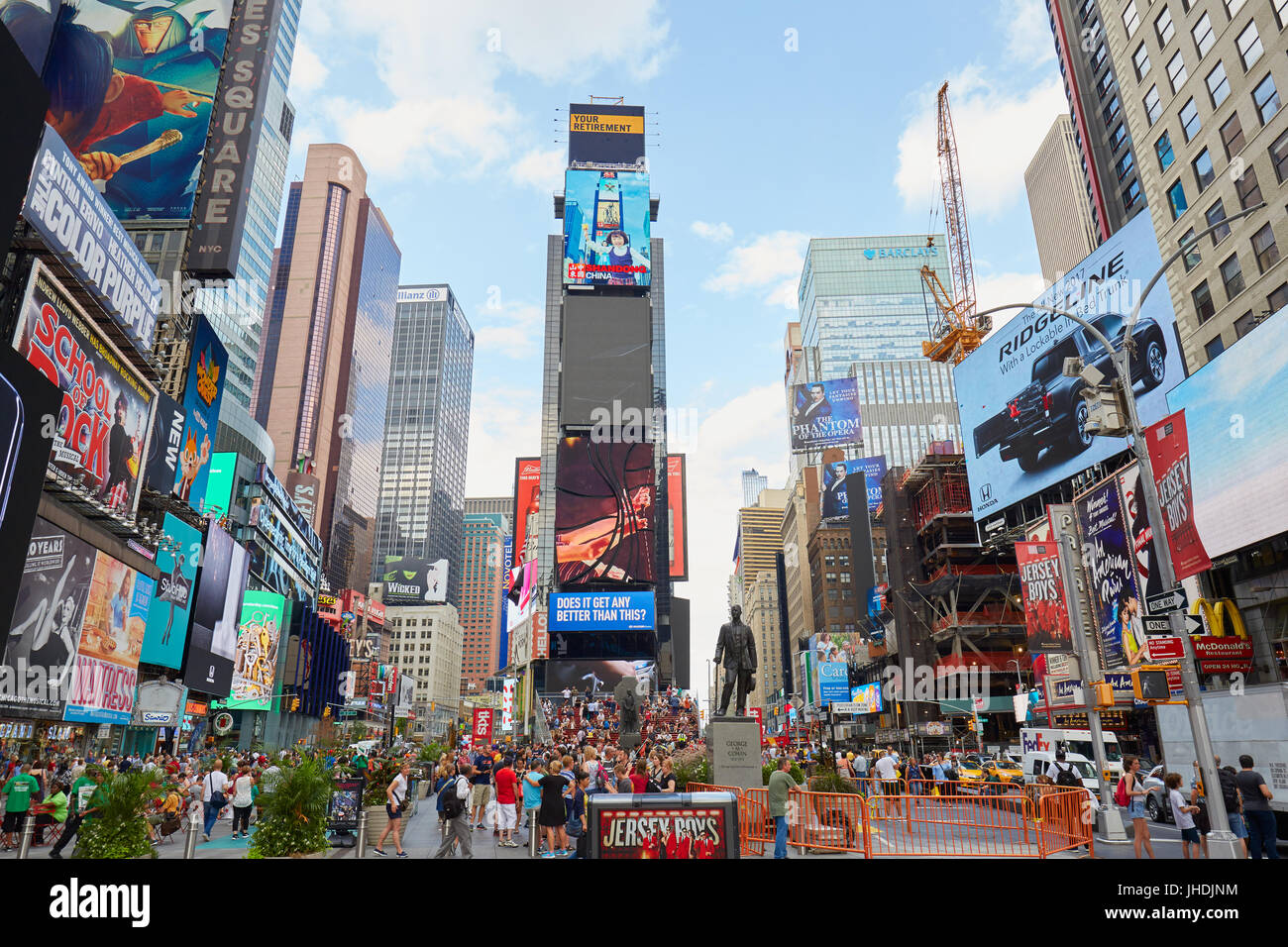 Times Square view with people and advertising billboards in New York - Stock Image