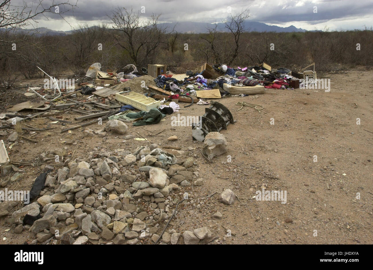 Discarded trash was dumped illegally on public land near Santa Rita Road, Sonoran Desert, Sahuarita, Arizona, USA. - Stock Image