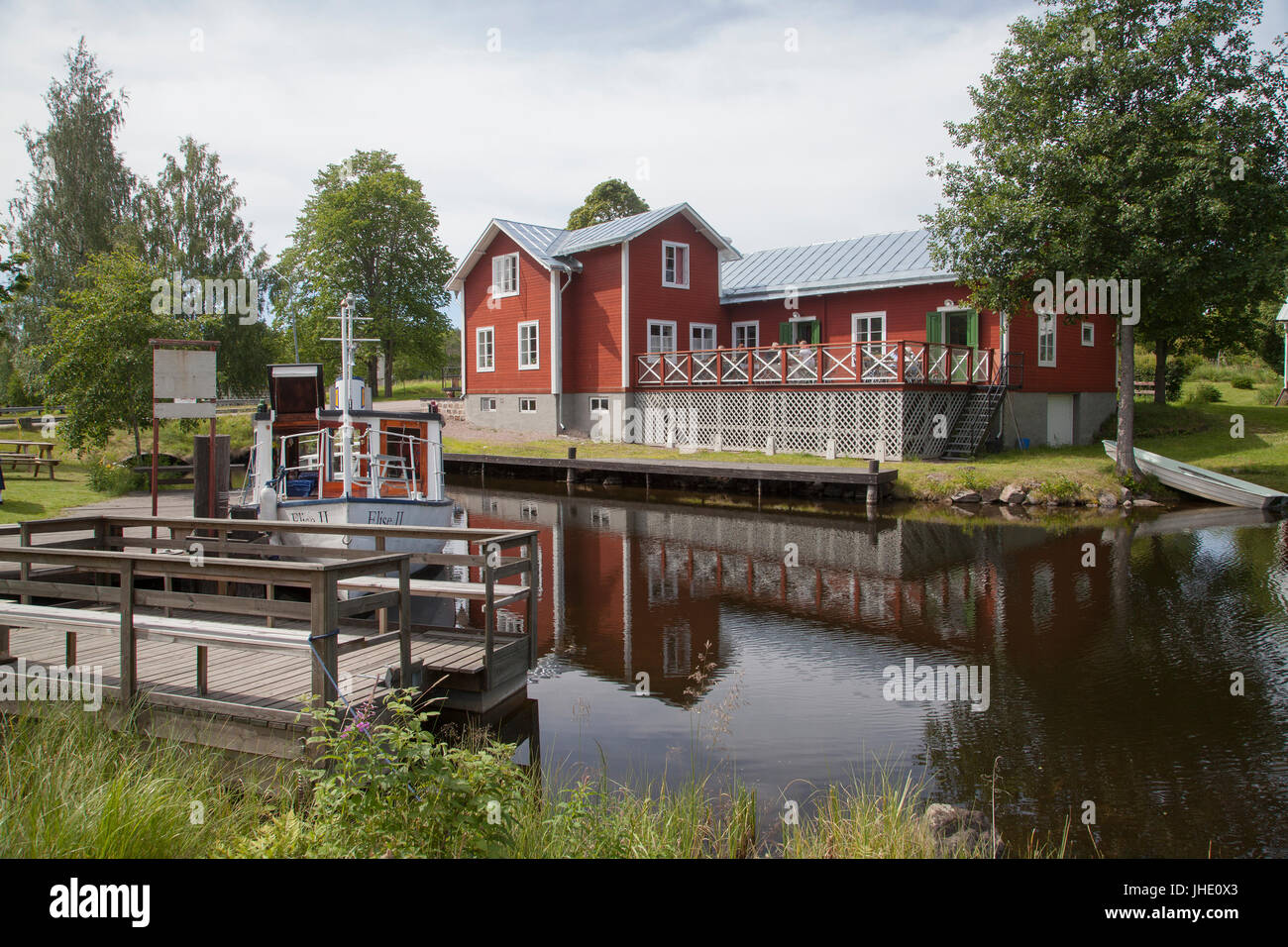 STJÄRNSUND industrial community in Dalarna 2017 Old boat at the Village pier - Stock Image