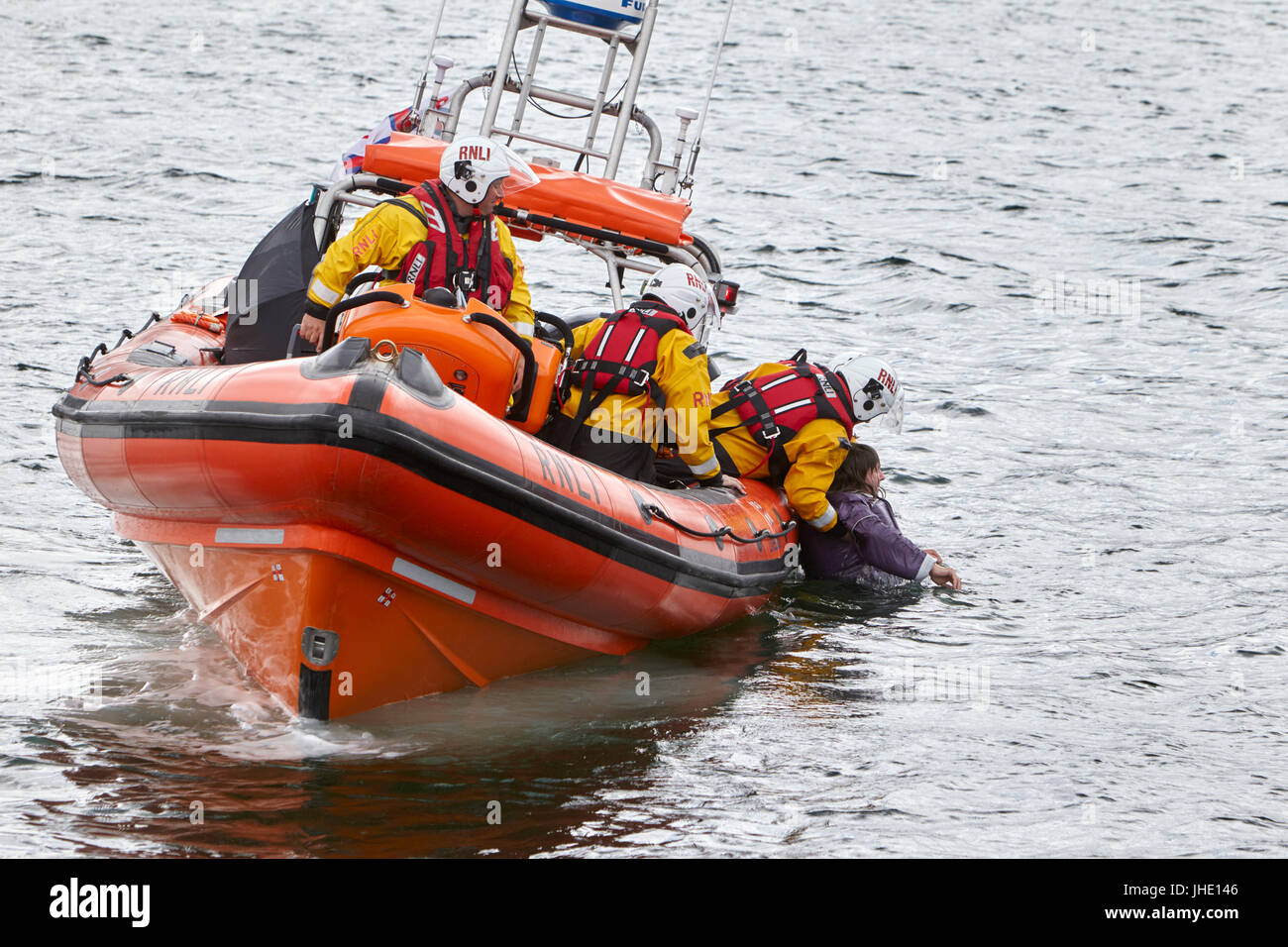 bangor rnli lifeboat jessie hillyard on safety demonstration recovering man from the sea northern ireland - Stock Image