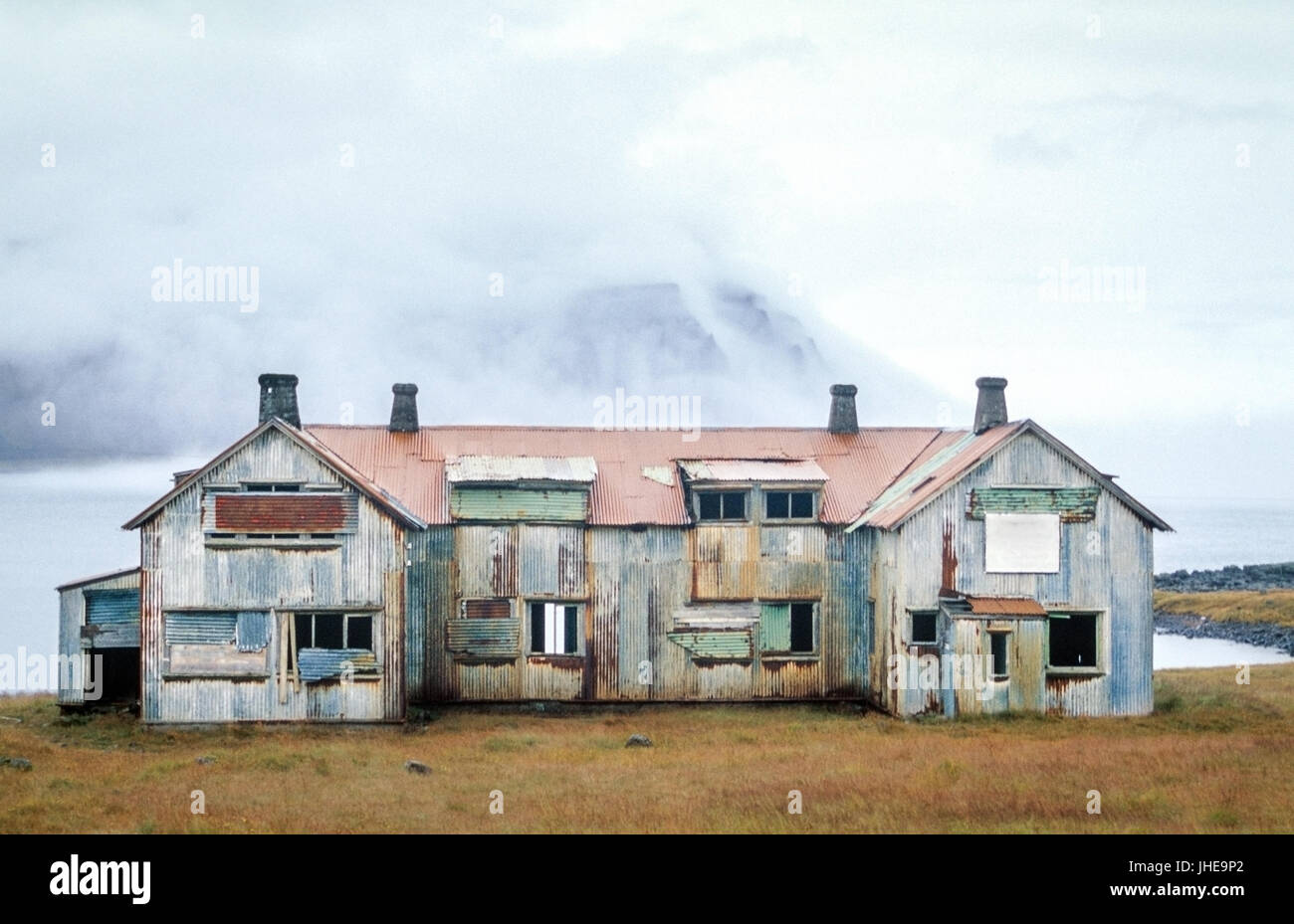 Old abandoned haunted house. Ruin at a fjord in Iceland. Stock Photo