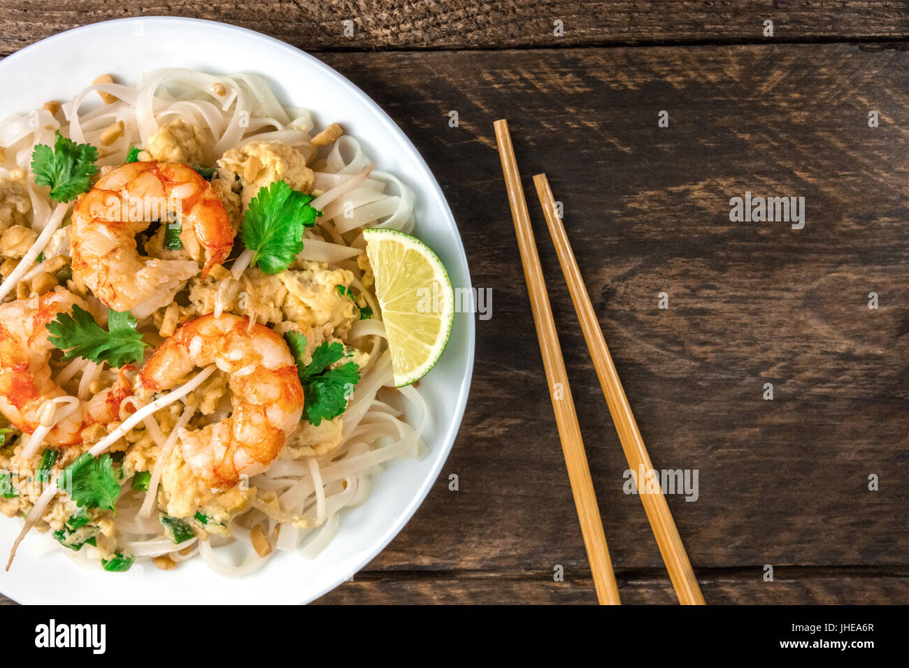 Shrimp Pad Thai closeup from above with copy space - Stock Image