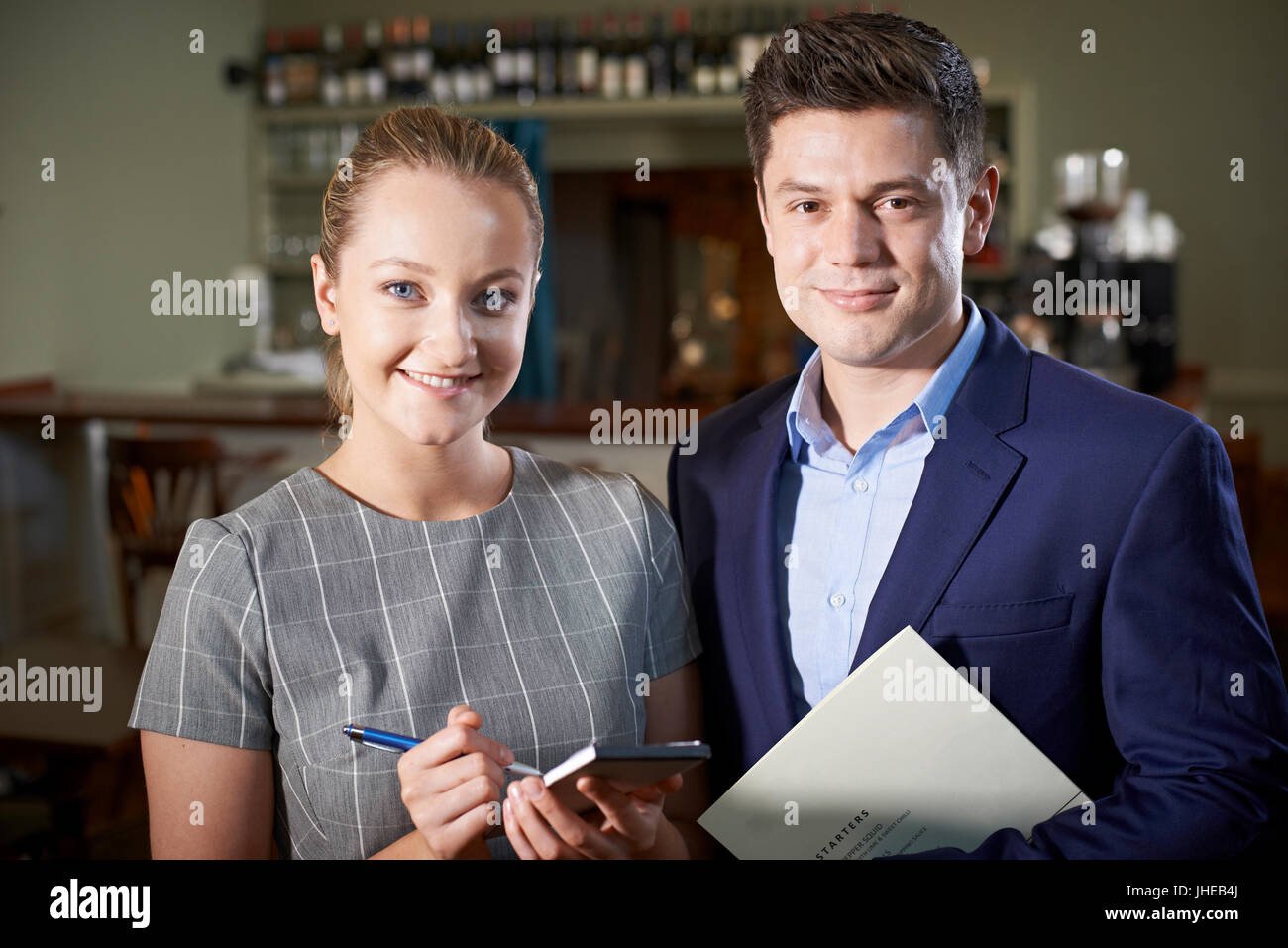 Portrait Of Owner With Waitress In Restaurant - Stock Image