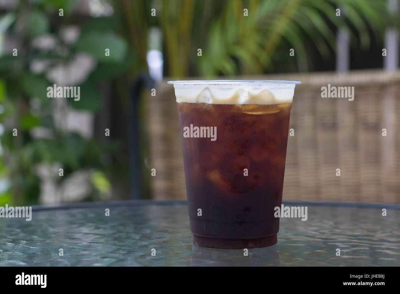 Sparkling Nitro cold brew coffee ready to drink in take away cup. - Stock Image