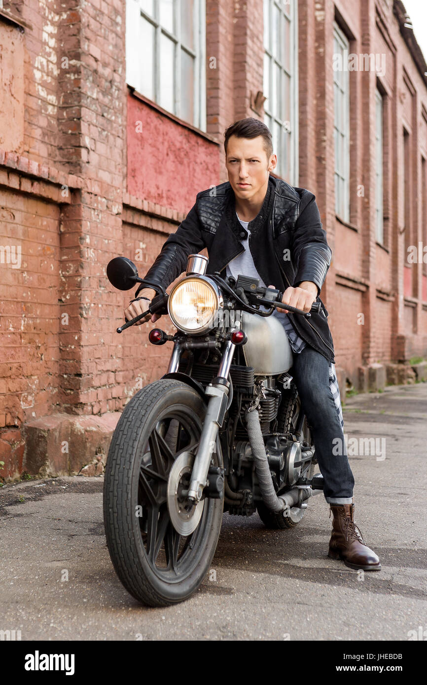 Handsome Rider Biker Guy In Leather Jacket Sit On Classic Style Cafe Racer Motorcycle And Ready For Long Ride Bike Custom Made Vintage Garage Bru