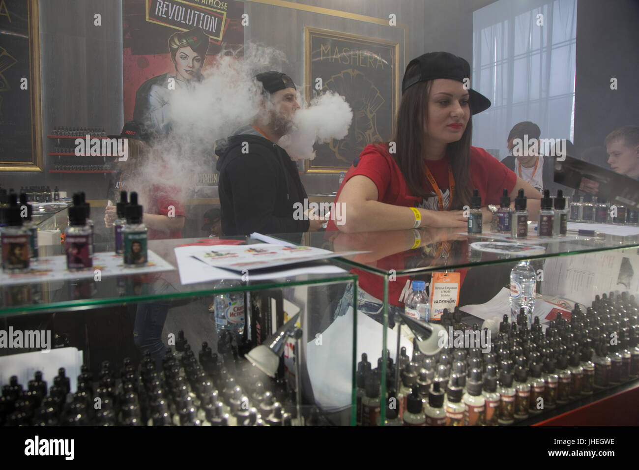 People smoke electronic cigarettes at the vape shop in Moscow, Russia - Stock Image