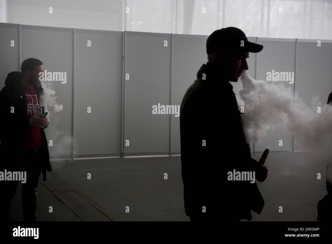 A man smokes electronic cigarettes at the 'Vape Show' exhibitionin  in Moscow, Russia - Stock Image