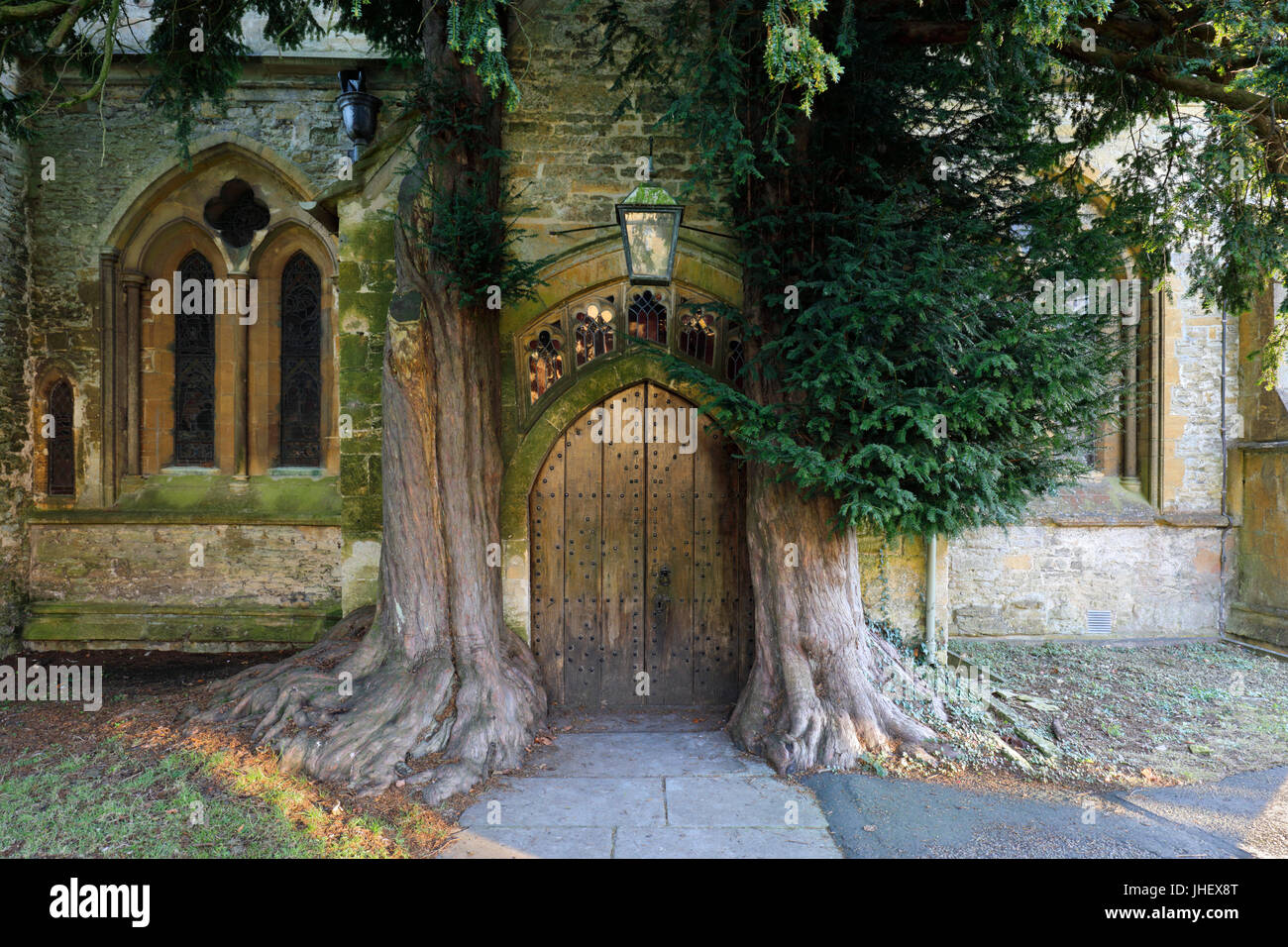 Yew trees and door of St Edward's church, Stow-on-the-Wold, Cotswolds, Gloucestershire, England, United Kingdom, Stock Photo