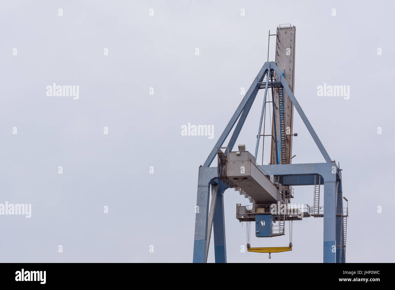 Container crane against blue sky at the port of Hundested, Denmark, July 10, 2017 - Stock Image