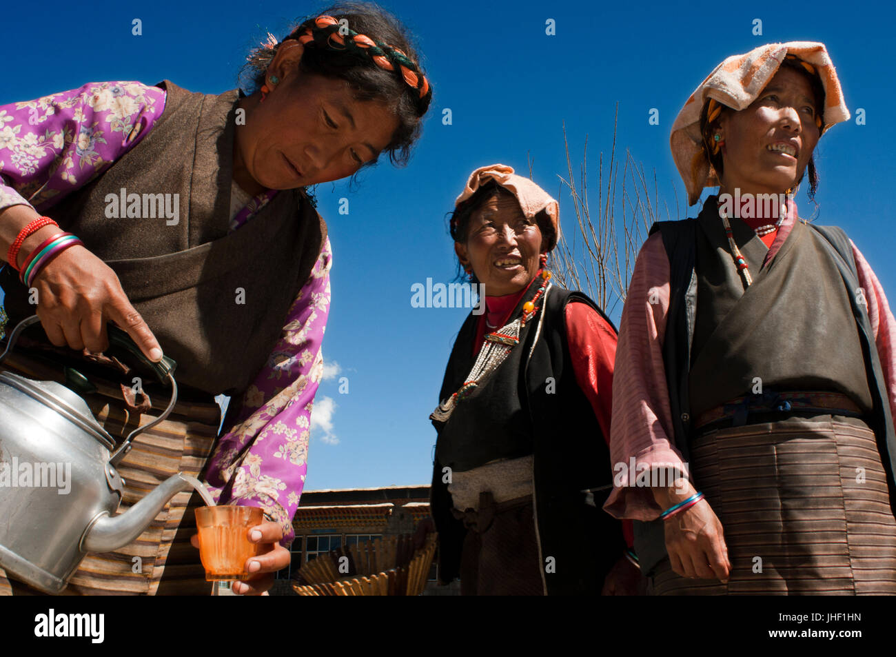 A family celebrates the graduation of a relative in the village of Bainans, located along the road separating Shigatse - Stock Image