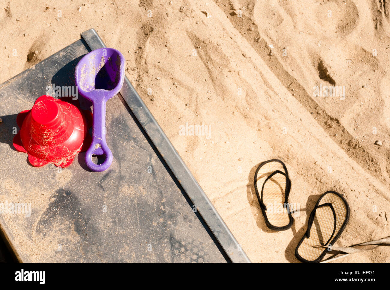 Toys left behind on a beach in Venice California USA - Stock Image