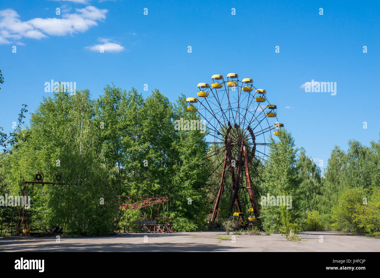 An abandoned ferris wheel in Pripyat, close to Chernobyl, where the nuclear catastrophy occured in 1986. - Stock Image