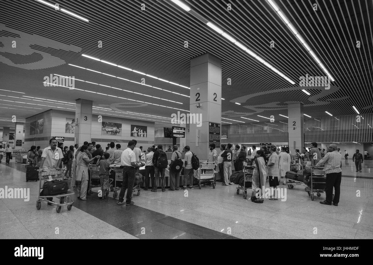 KOLKATA, INDIA - JUL 29, 2015. People waiting for taking luggages at Arrival hall of Netaji Subhash Chandra Bose - Stock Image