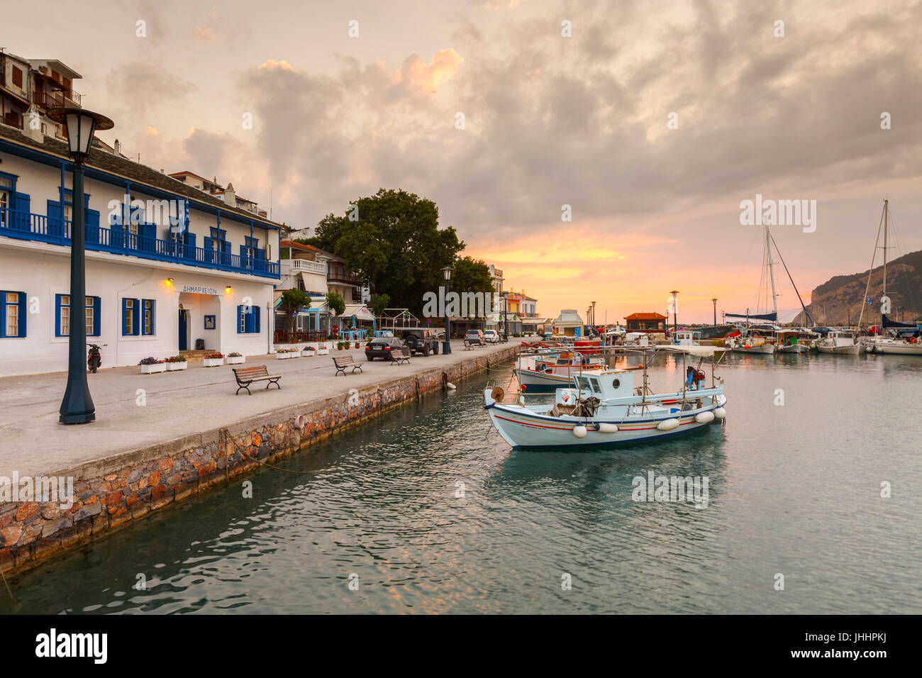 Town hall and the port of Skopelos town, Greece. - Stock Image