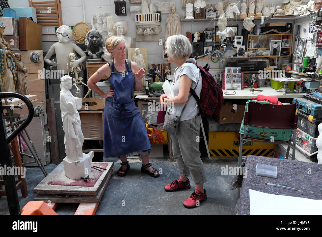 A visitor to stone carver Nina Bilbey's sculpture studio interior open to visitors at the E17 Art Trail 2017 - Stock Image