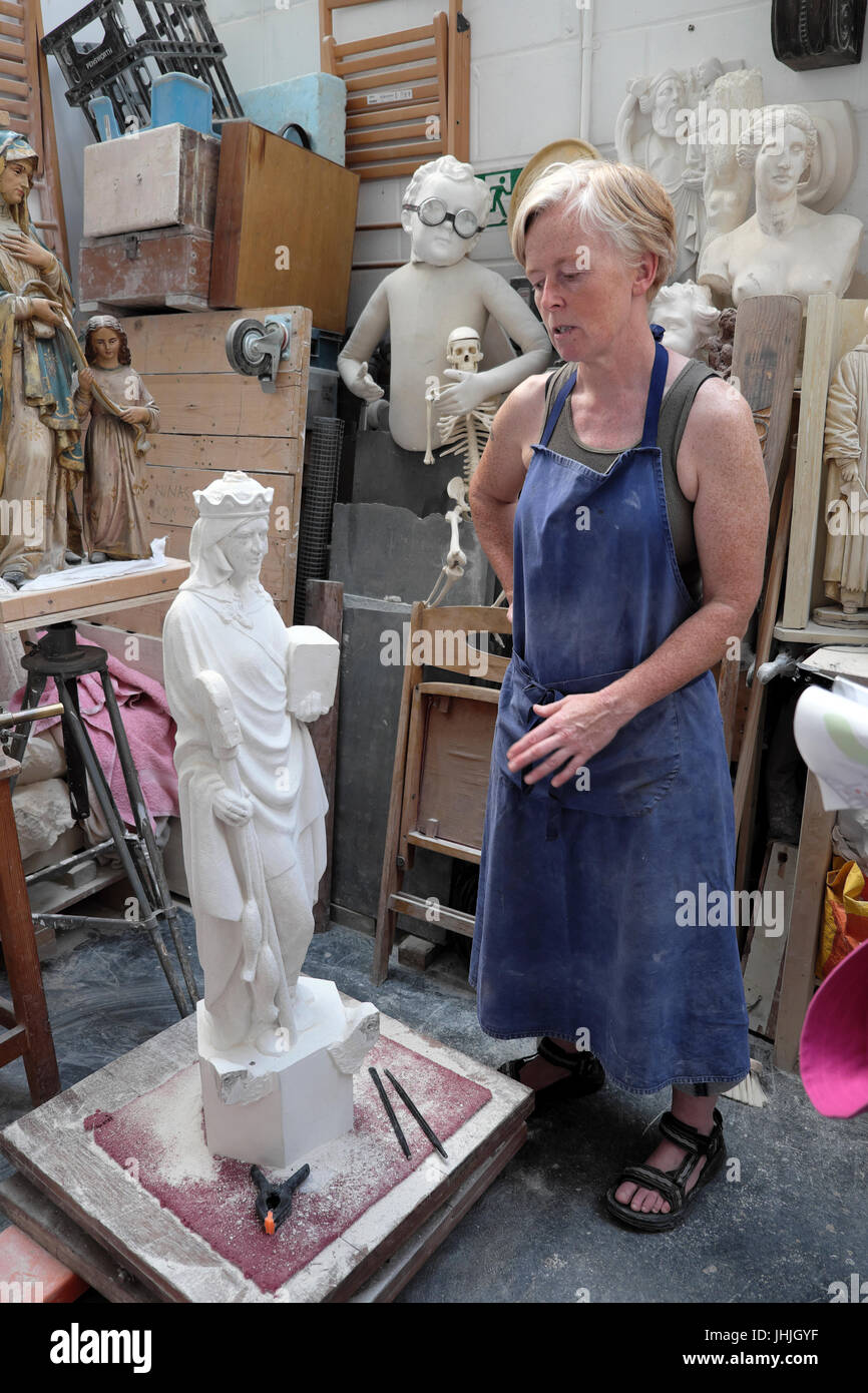 Stone carver sculptor Nina Bilbey in her sculpture studio open to visitors at the E17 Art Trail 2017 in Walthamstow - Stock Image