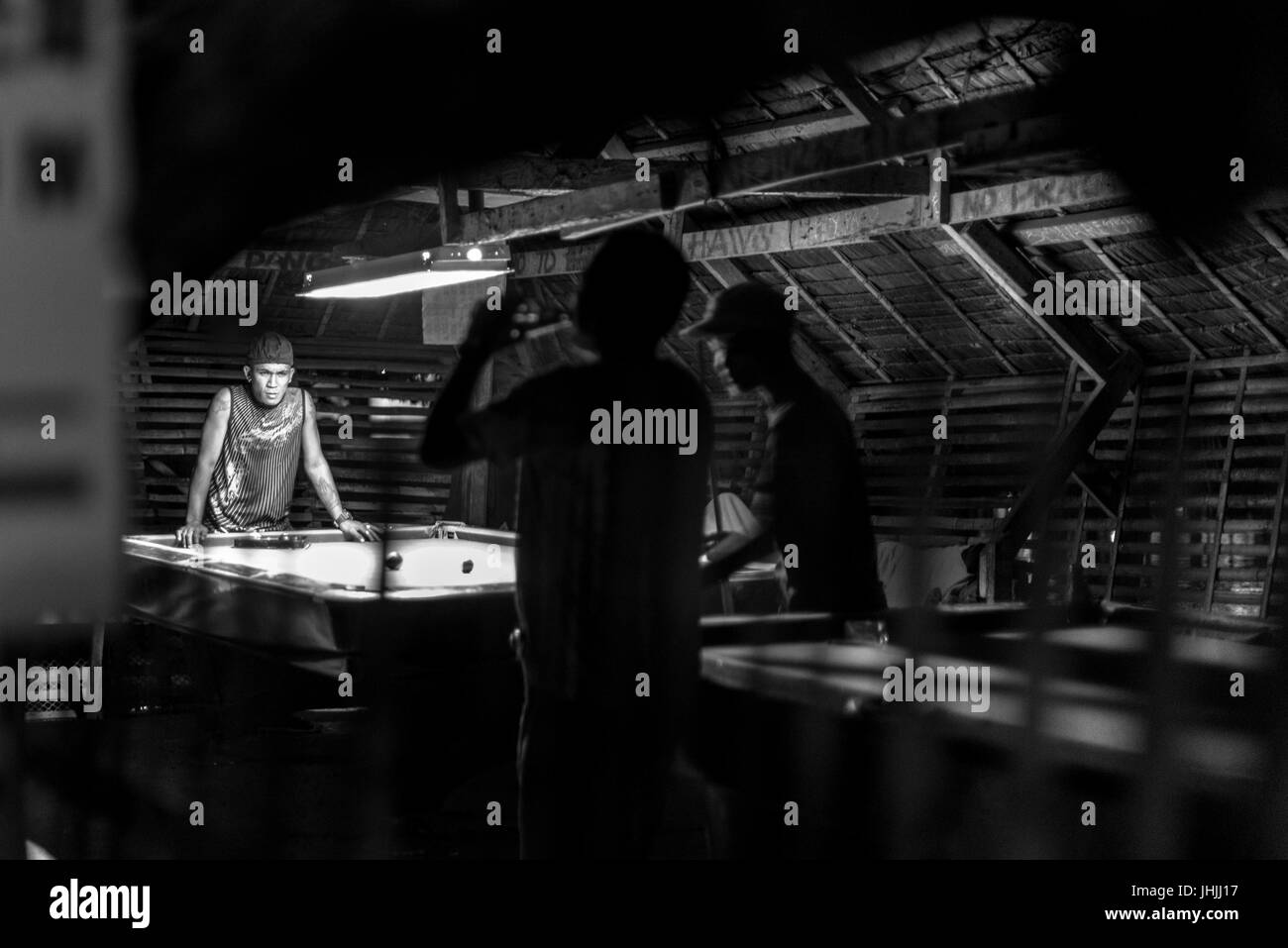 BORACAY, WESTERN VISAYAS, PHILIPPINES - JANUARY 16, 2015: Black and white picture of filipinos playing snooker. - Stock Image