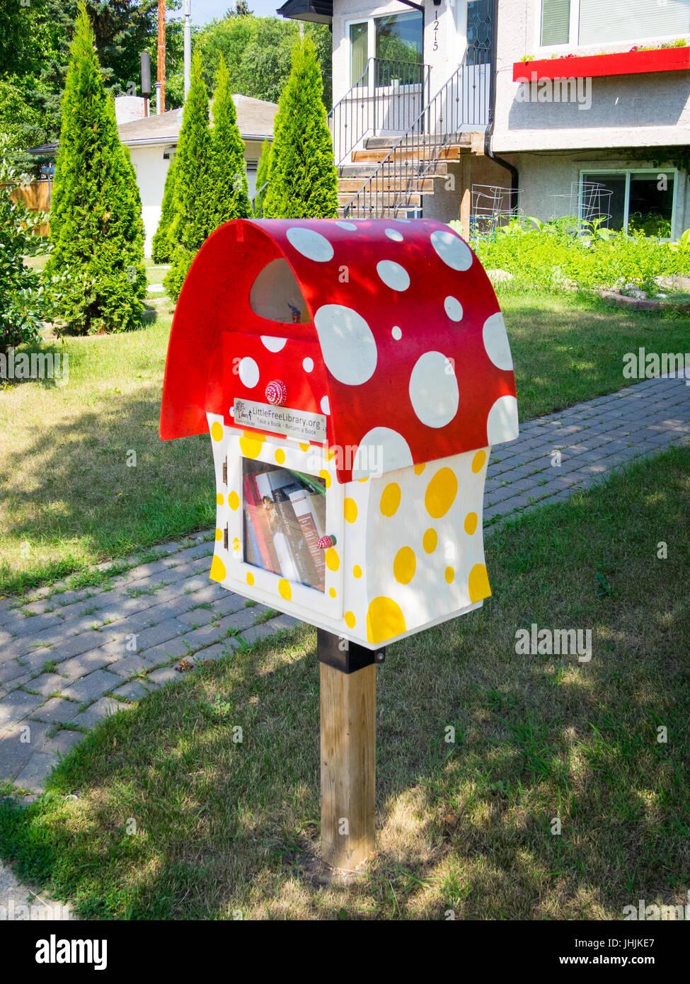A cute Little Free Library book exchange box in Saskatoon, Saskatchewan, Canada. - Stock Image
