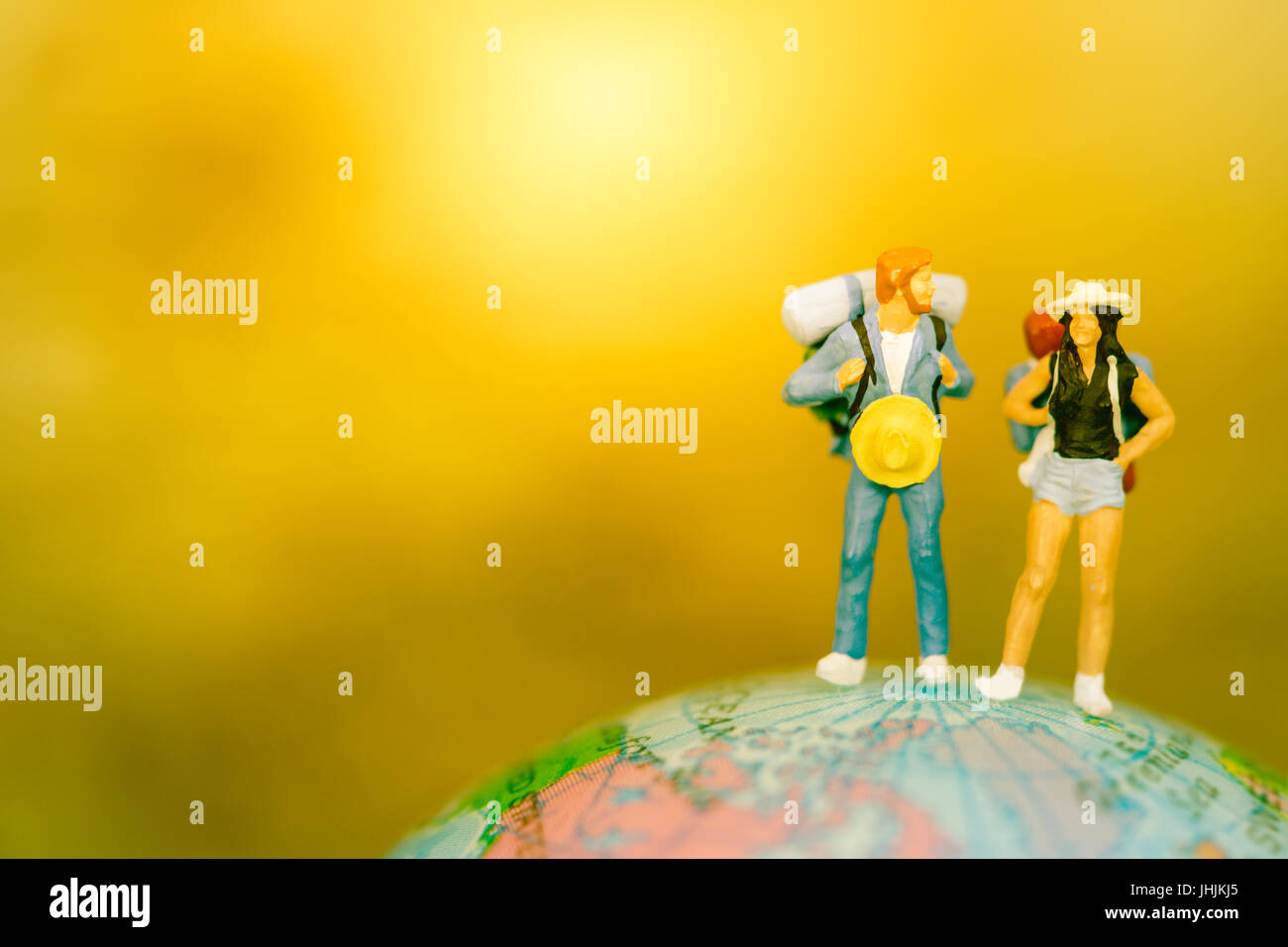 Global Warming and Pollution,Save the wold,Green Earth day concept. Miniature people: Couple backpacker, mini figure, - Stock Image