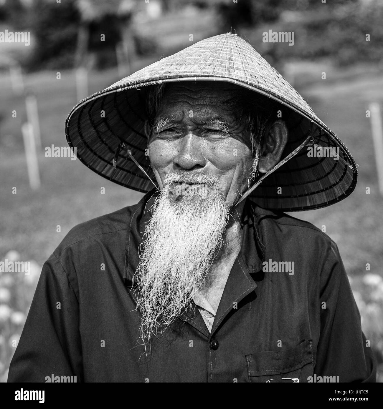 Bearded old man of Vietnam in a conical hat - black and white Stock ... e19684bc88b