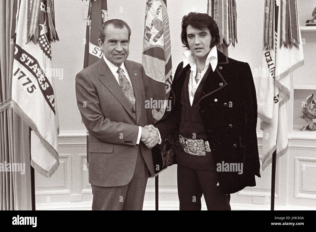 President Nixon shaking hands with entertainer Elvis Presley in the Oval Office of the White House on December 21, - Stock Image