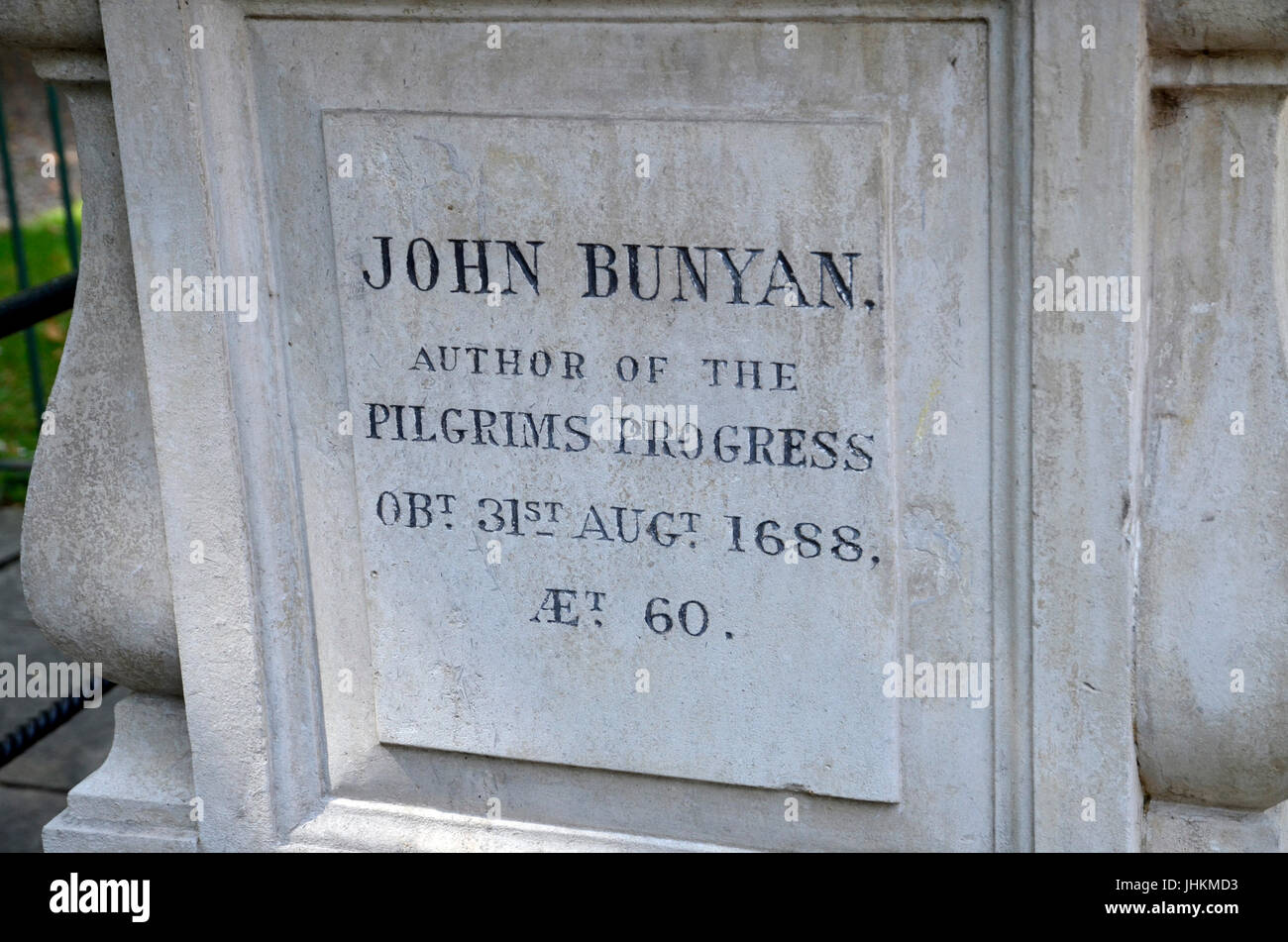 The gravestone of author and poet John Bunyan in Bunhill Fields Cemetary, Finsbury, London - Stock Image