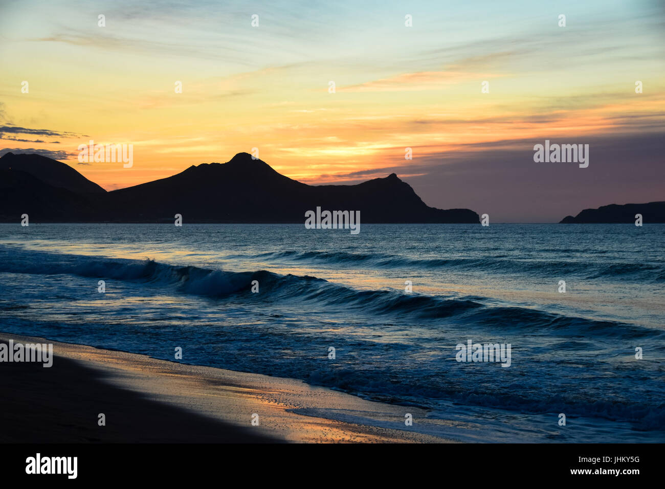 Sunrise over the headland to the east of Vila Baleira in Porto Santo Island, Madeira, Portugal - Stock Image