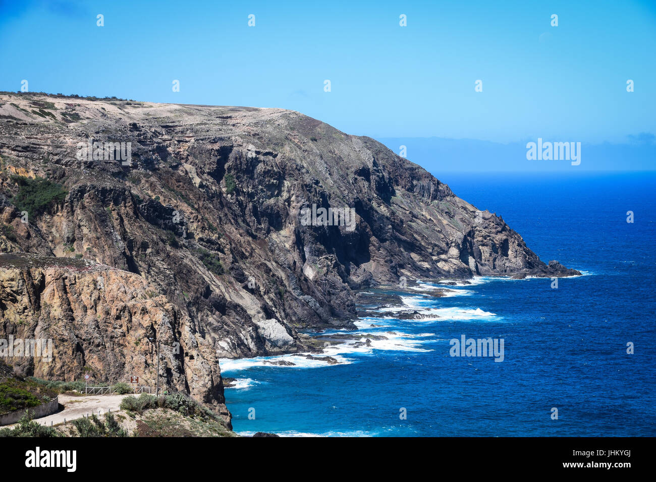 Rocky coastline at Fonte da Areia on the northern coast of Porto Santo Island, Madeira, Portugal - Stock Image