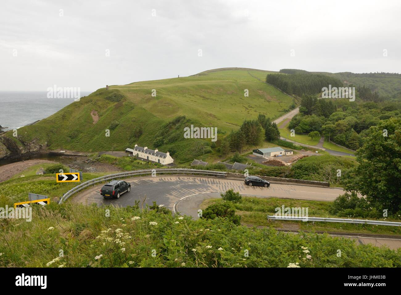 Hairpin bend at Berriedale Braes viewpoint looking over the cliffs on the North East of Scotland and part of the - Stock Image