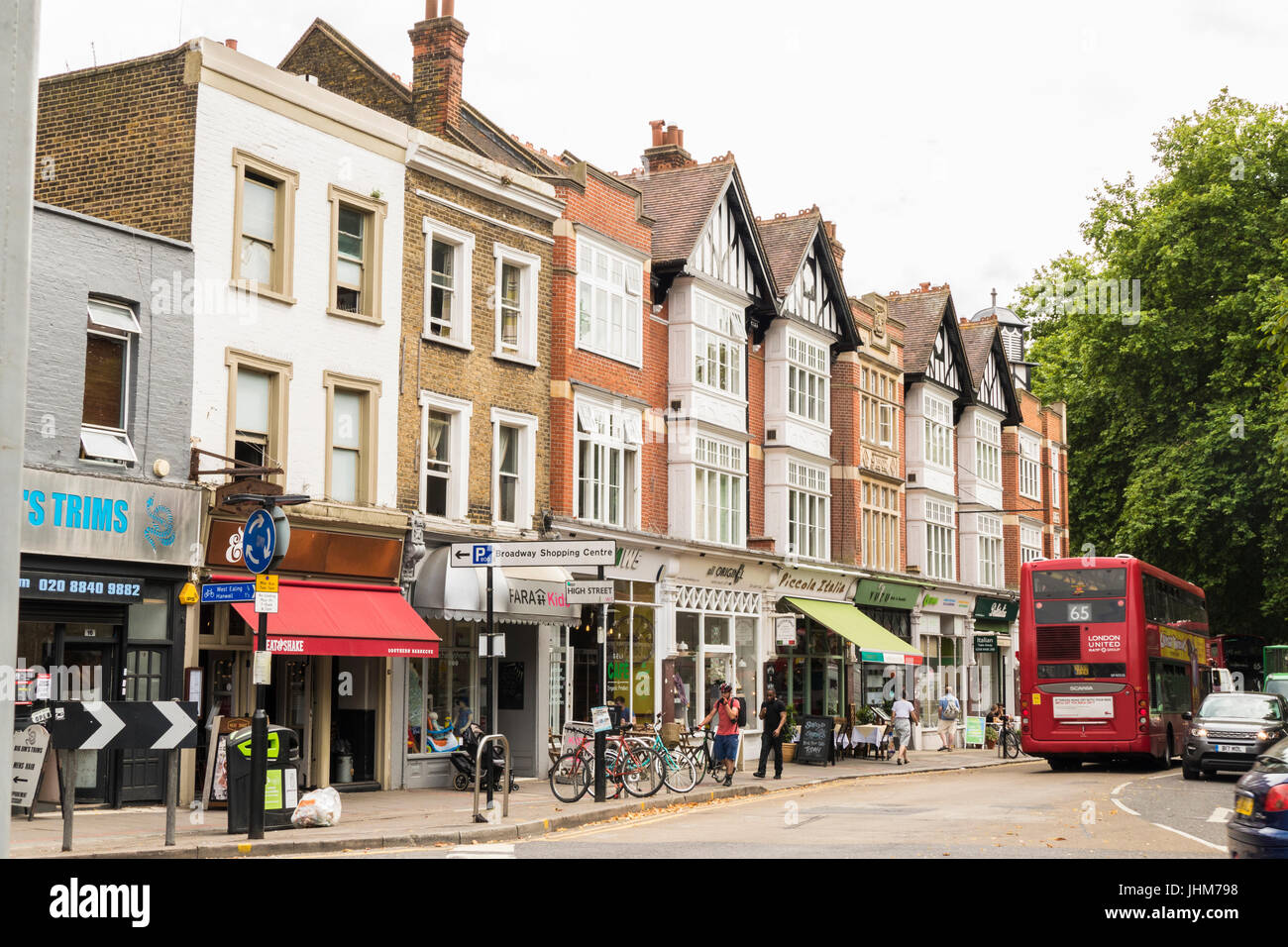 People, period architecture and shops in Ealing, London W5, England, UK. - Stock Image