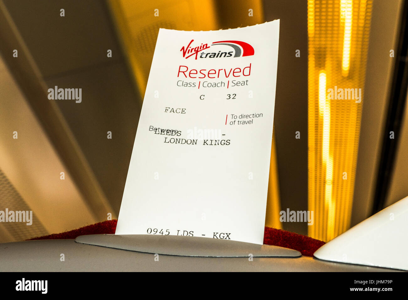 A reserved seat ticket in the seat of Virgin Trains between London Kings Cross and Leeds, England, UK. - Stock Image