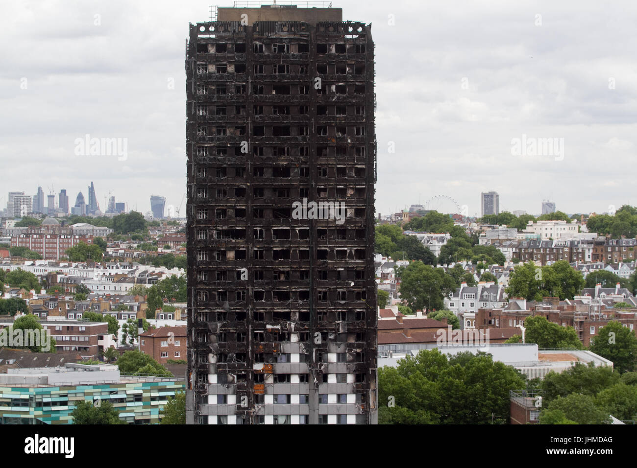 London UK. 14th July 2017.  Remains of the Grenfell  residential tower block in West London one month after it was - Stock Image