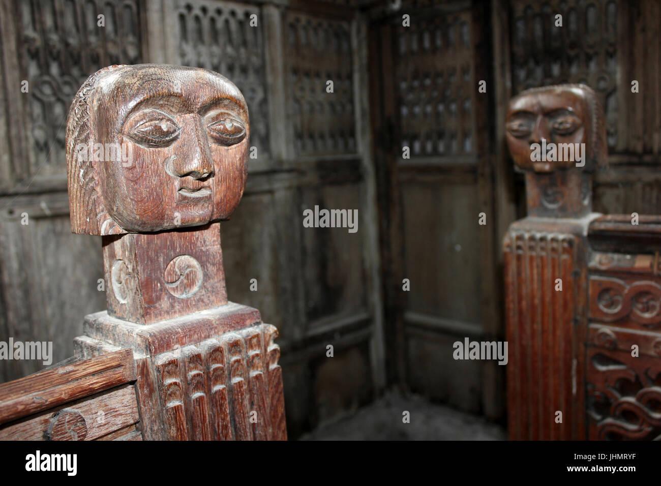 Carved Pew Heads in Gwydir Chapel, St Grwst's Church, Llanrwst - Stock Image