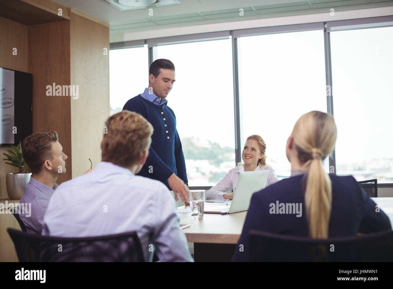 Business people discussing during meeting in board room - Stock Image