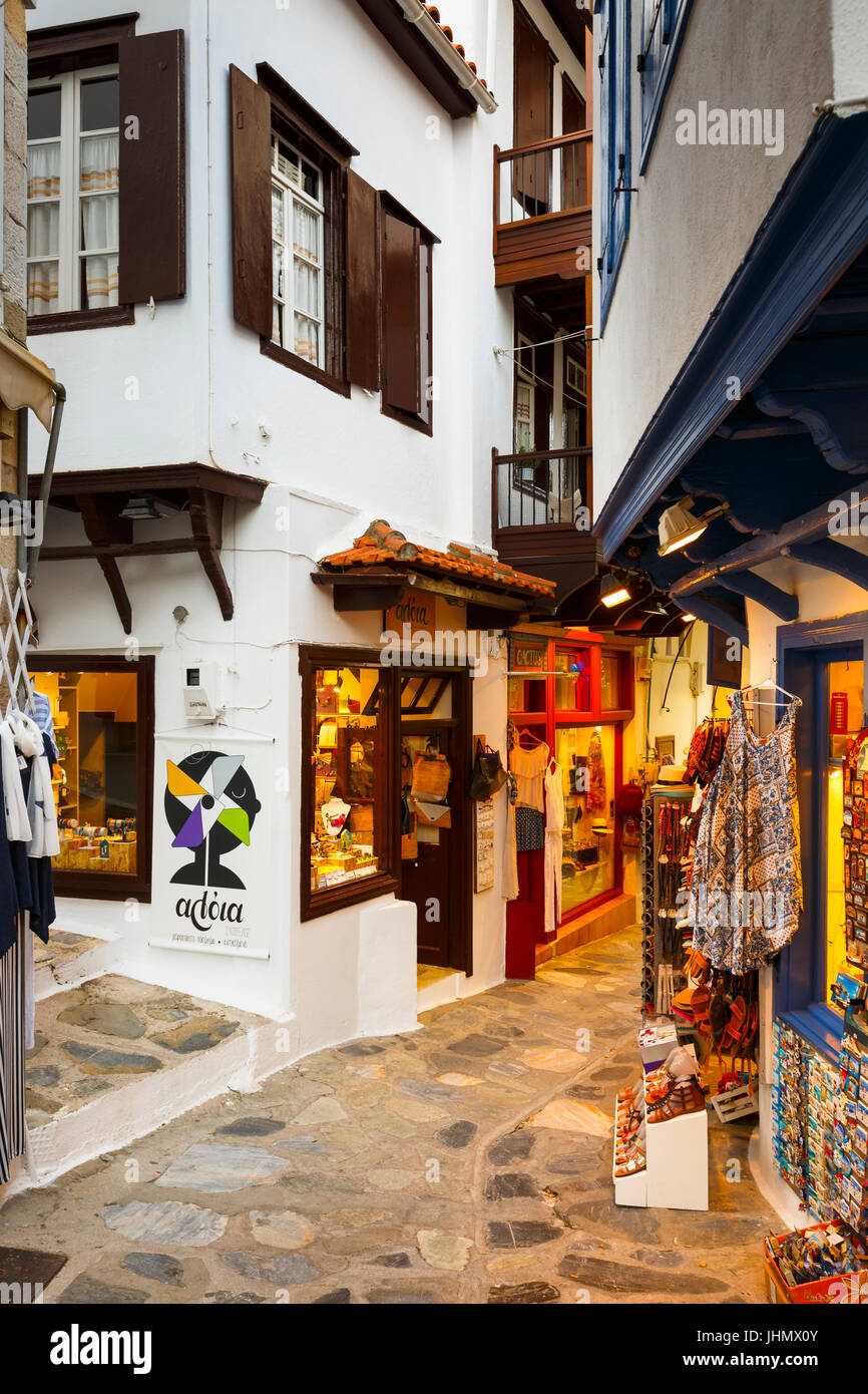 Street with shops in Skopelos town, Greece. - Stock Image