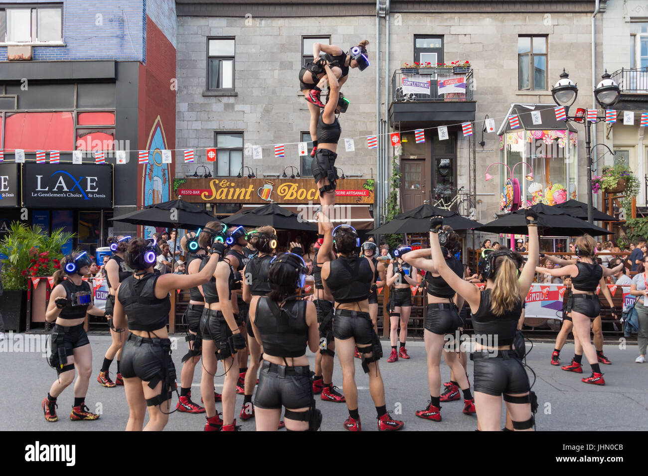 """Montreal, Canada - 13 July 2017: """"Minutiens"""" Street performers with VR headsets during Montreal Circus Arts Festival Stock Photo"""