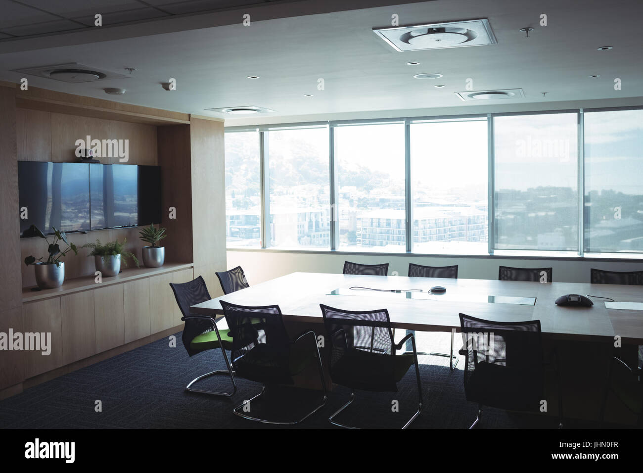 Interior of empty board room at office - Stock Image