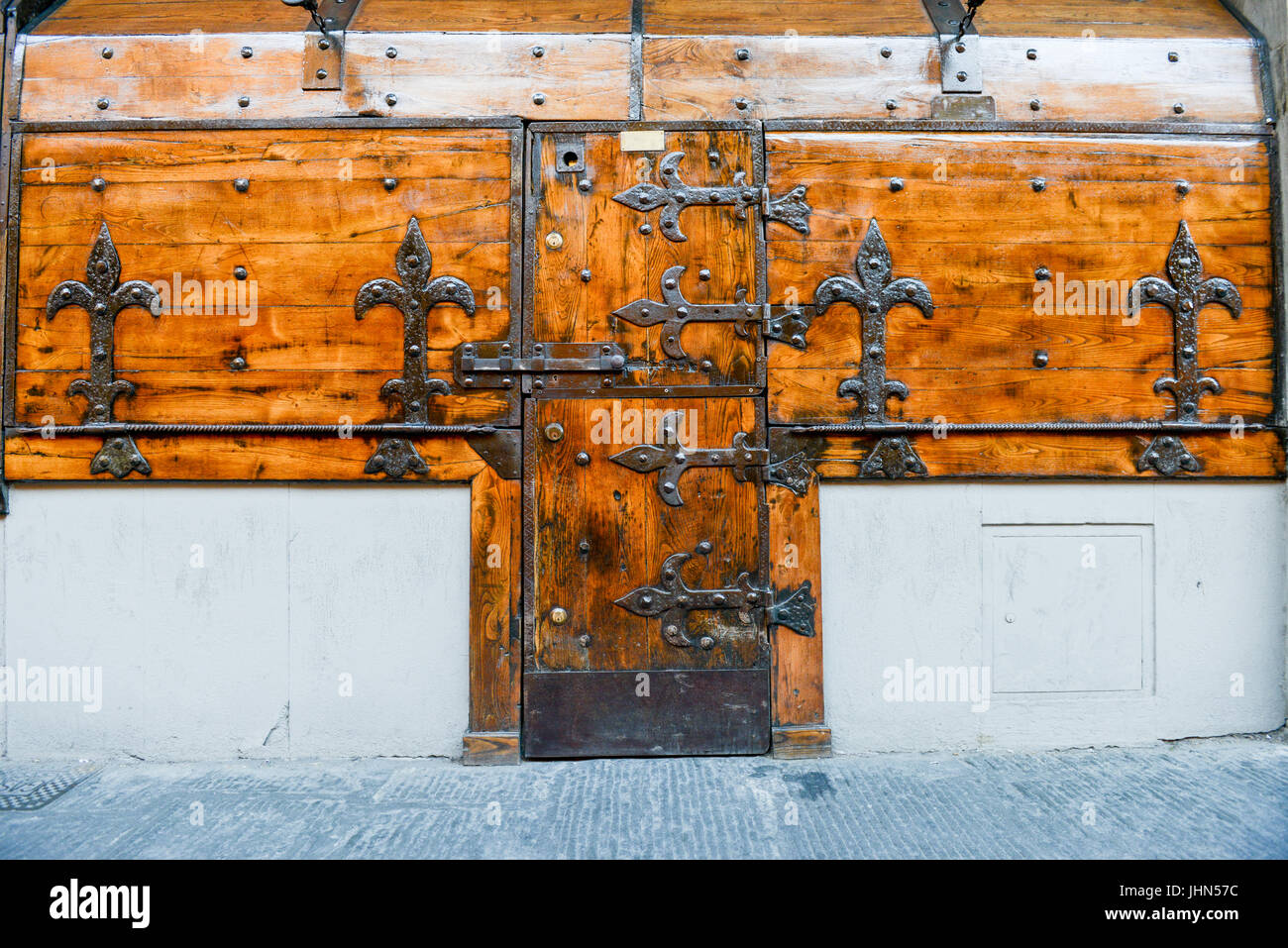 Antique closed door and windows of a shop at Firenze on Italy - Stock Image