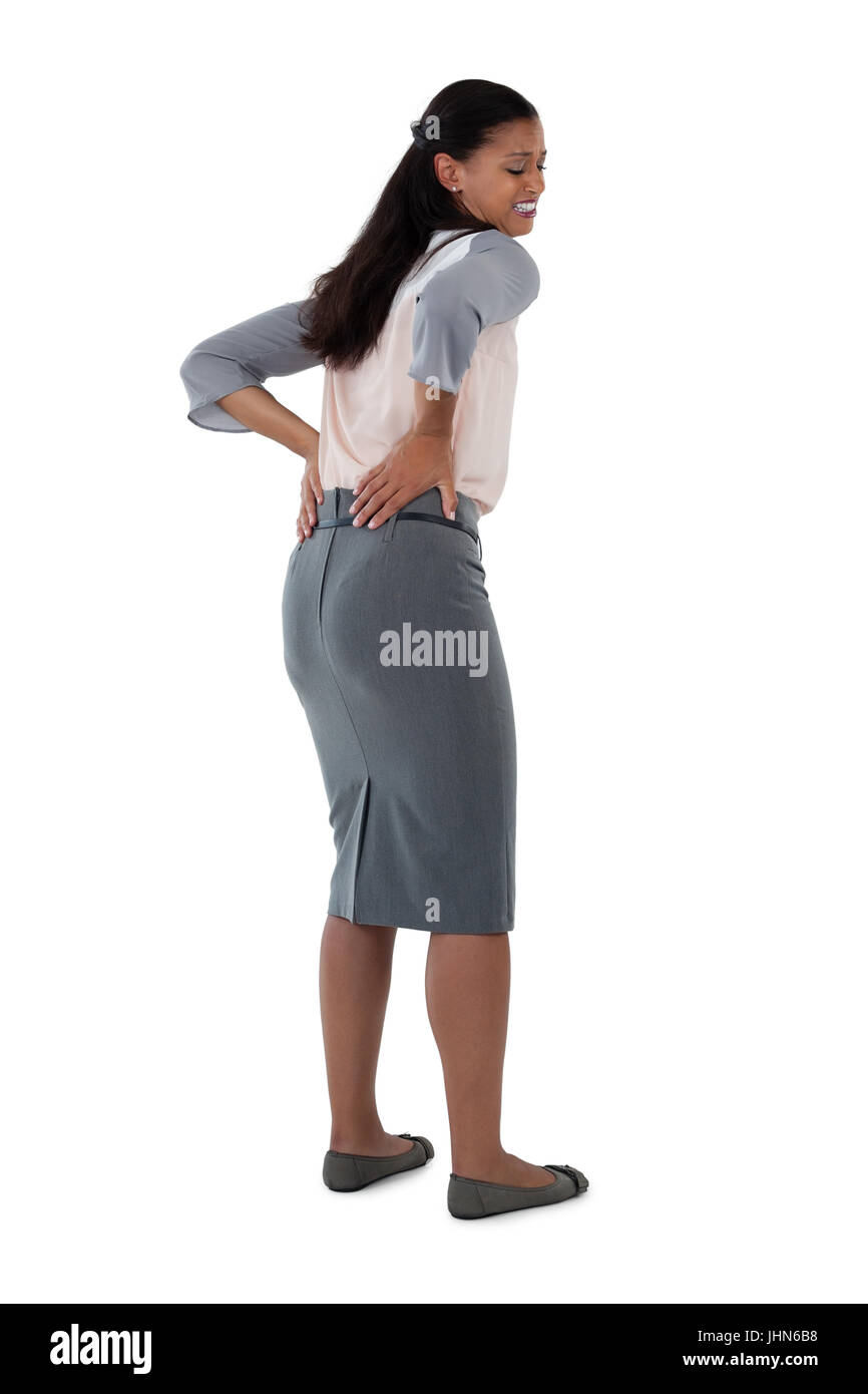 Close-up of businesswoman having an backache - Stock Image