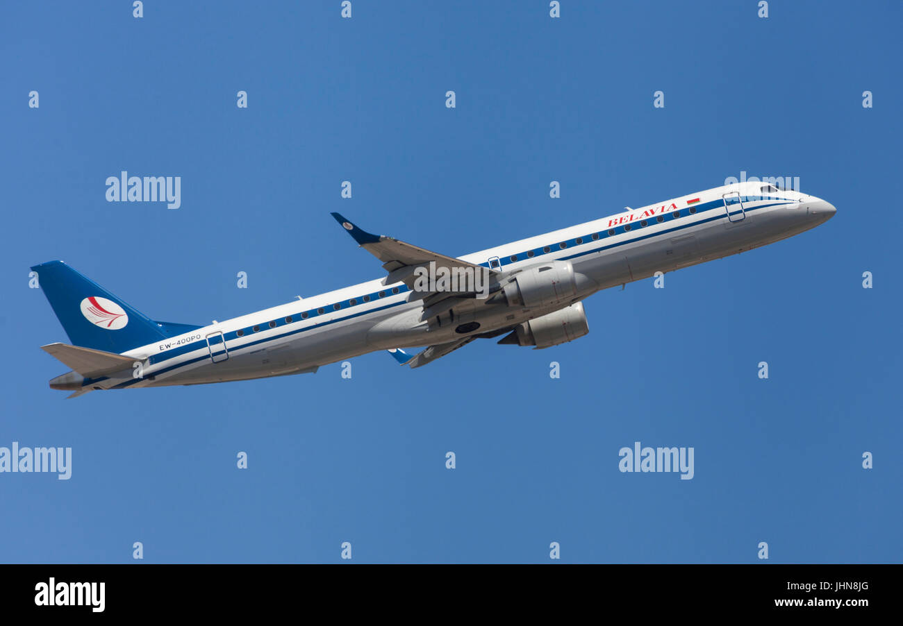 Belavia Embraer ERJ-195 taking off from El Prat Airport in Barcelona, Spain. - Stock Image