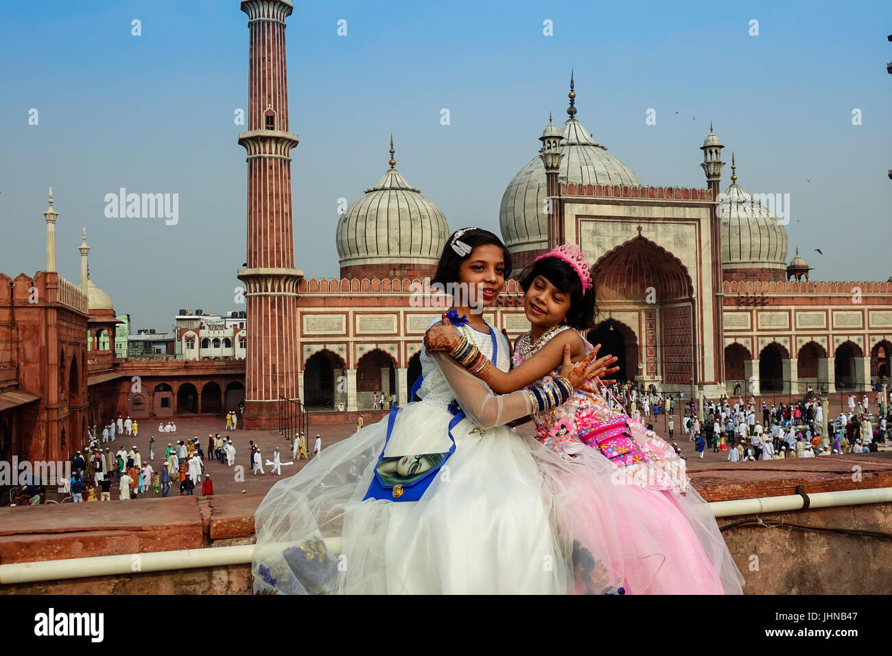 Two muslim kids with happy smiley faces celebrating islamic festival eid ul fitr the festival of love and joy in - Stock Image