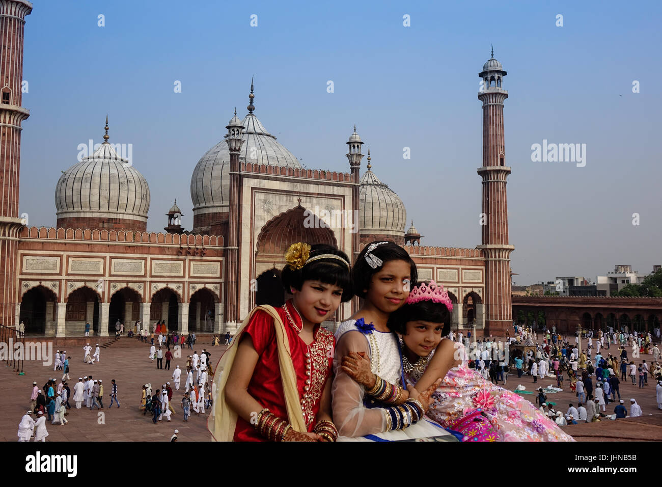 Three muslim girls with happy smiley faces celebrating islamic festival eid ul fitr the festival of love and joy - Stock Image