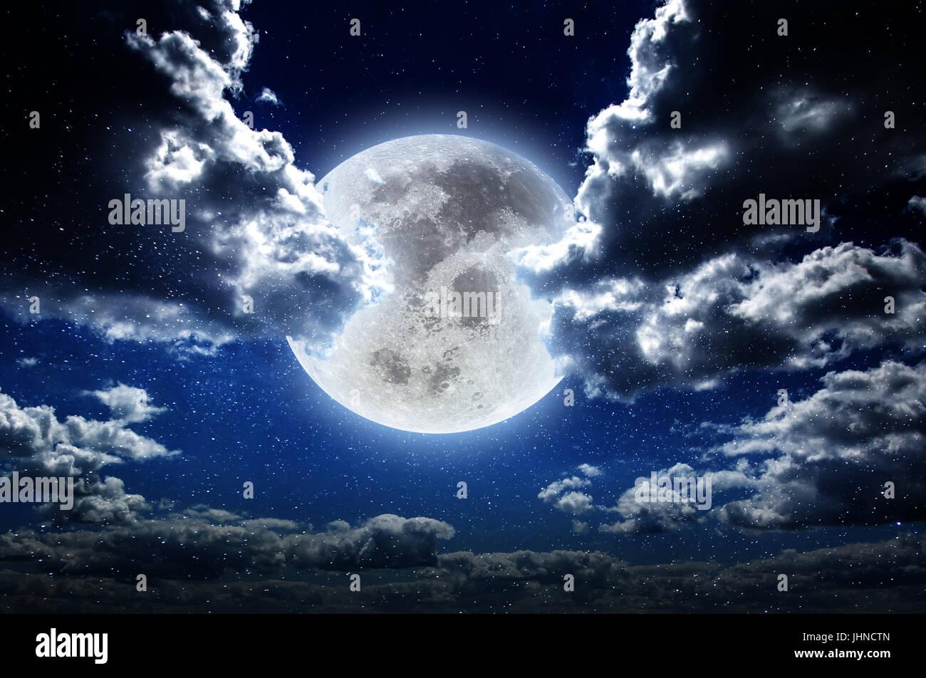 Moon at night in galaxy stars sky - Stock Image