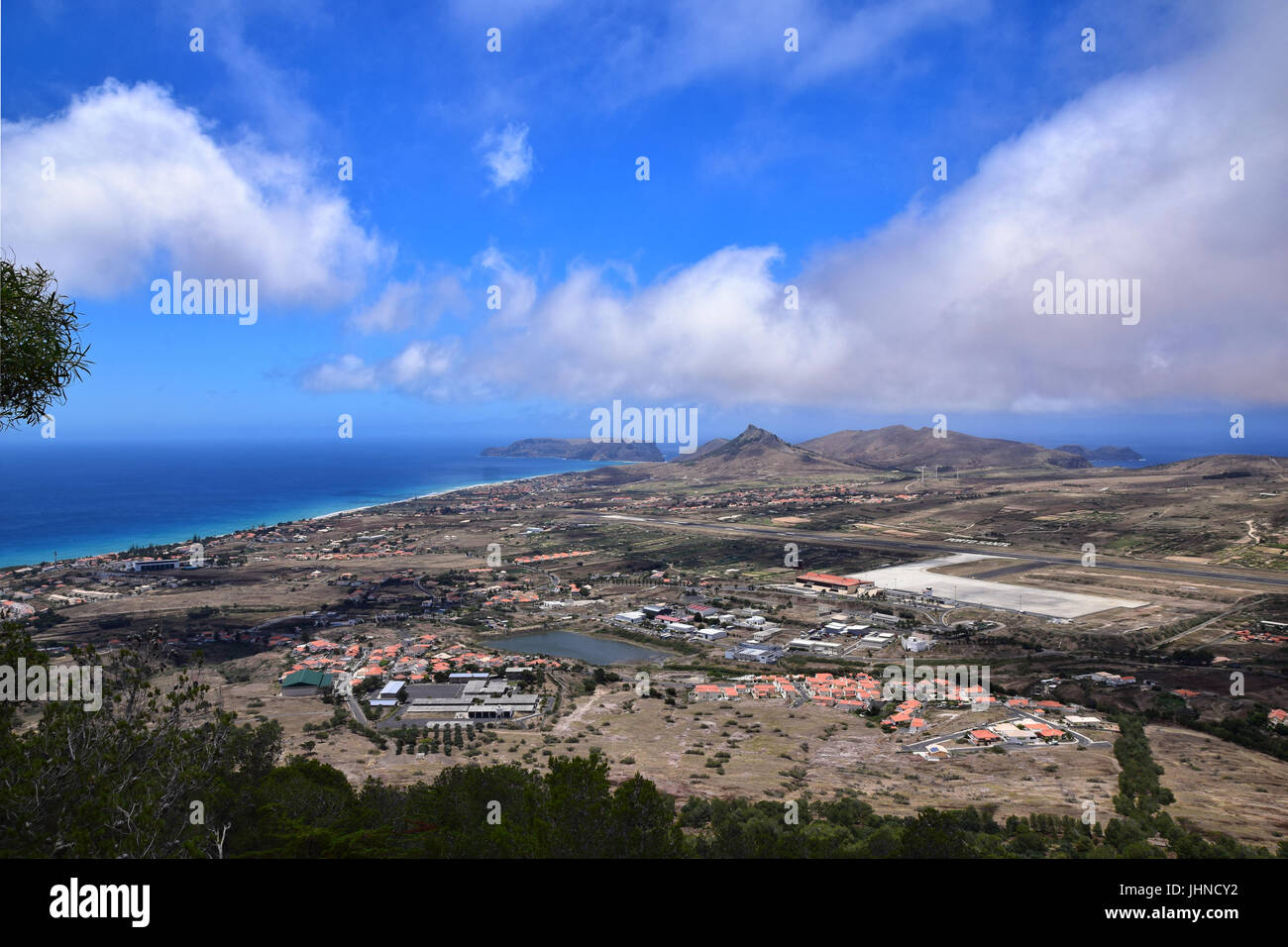 View of the town of Vila Baleira, Ilheu da Cal and International Airport from Pico do Castelo on Portuguese Atlantic - Stock Image