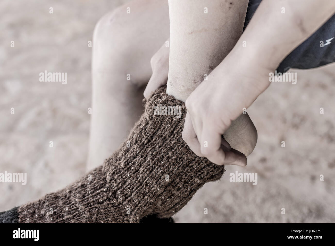 Boy in Traditional Handmade Knitted Wool Socks - Stock Image